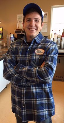 UDairy Creamery student employee wearing a UDairy Creamery flannel shirt